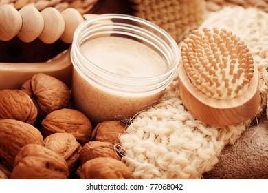 walnut body scrub with massage glove - beauty treatment