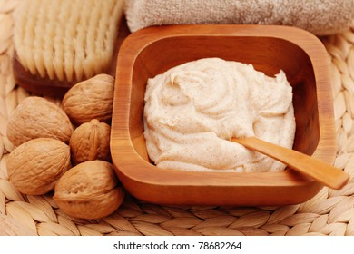 walnut body scrub with some walnuts - beauty treatment