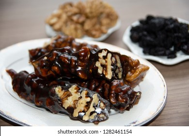 walnut coated with fruit pulp, sweet sucuk, local snacks from turkey, greece, middle east