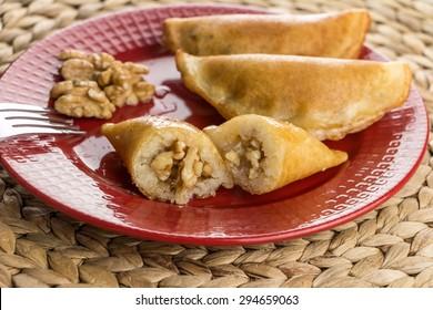 Walnut Fried Qatayef on Red Open