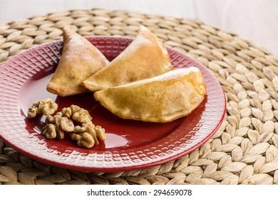 Walnut Fried Qatayef on Red