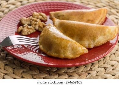 Walnut Fried Qatayef on Red Closeup