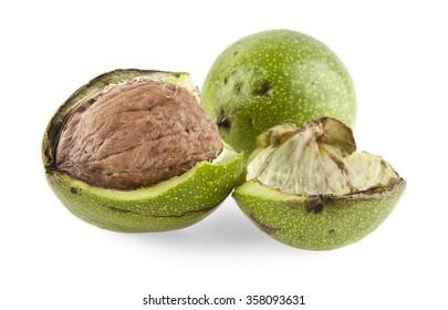 Walnut in green peel on white background