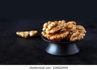 Walnut kernels on dark background, low key