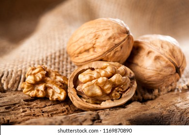 Walnut kernels on rustic old oak table.