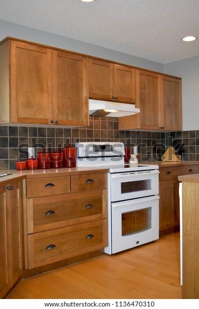 Walnut Kitchen Cabinets White Appliances Dark Stock Photo ...
