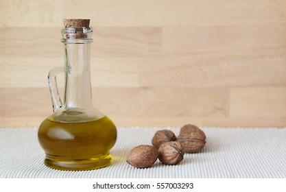 Walnut oil in glass carafe.