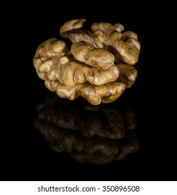Walnut on the black background with reflection