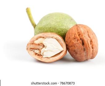 walnut and part of fresh nut isolated on white background