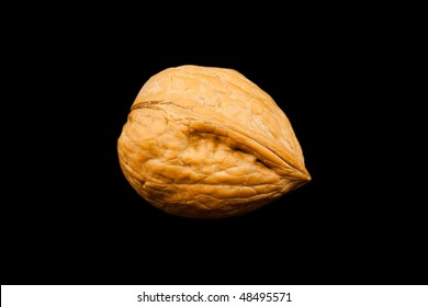 Walnut in shell isolated on black
