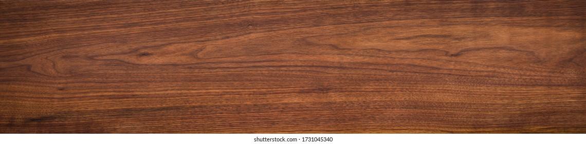 Walnut wood texture. Super long walnut planks texture background or ceramic tile.