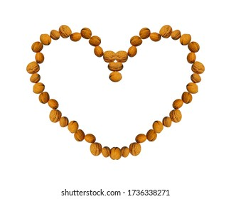 Walnuts arranged as an abstract heart, on a white background. Useful for food blog posts, banner, labels.