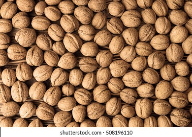 Walnuts background. Walnuts texture. Group walnuts on wooden background. Healthy organic food concept. Top view. View above