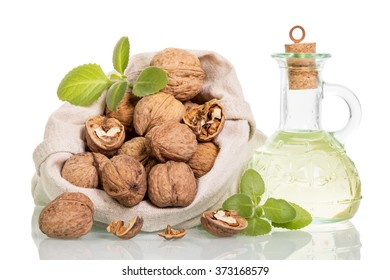 Walnuts in the bag and butter isolated on white background