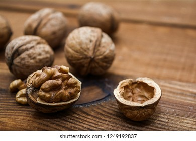 Walnuts closeup on a wooden background.