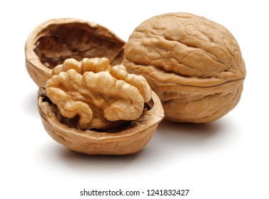 Walnuts and cracked walnut, isolated on white background
