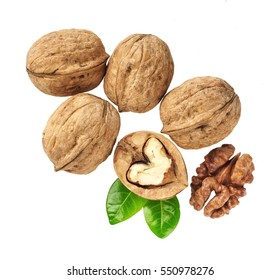 Walnuts with  green leaf isolated on white background, macro shot,top view