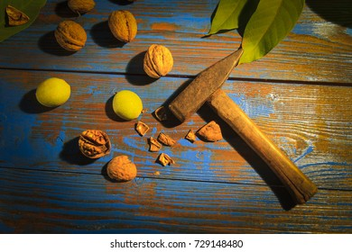 walnuts and hammer on the table