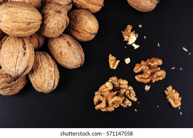 Walnuts isolated on black background