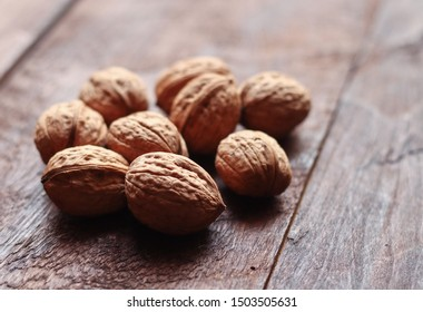 Walnuts isolated on the old wooden background in backlight - Shutterstock ID 1503505631