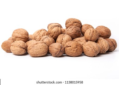 Walnuts kernels on dark desk with color background, Whole walnut in white background.
