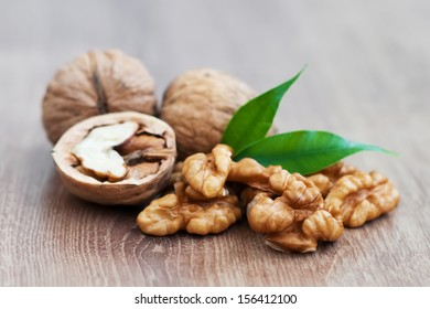 Walnuts with leaf  on a wooden  background