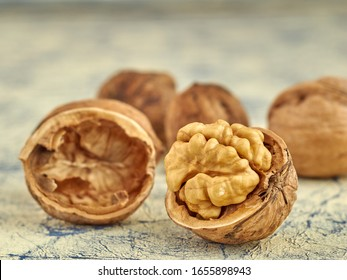 Walnuts lie on a light colored background