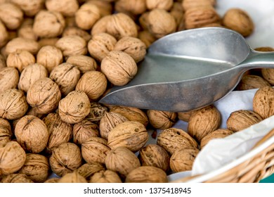 Walnuts on a market counter.