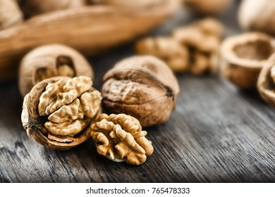 Walnuts on old rustic table in wooden bowl, Pile of Walnut kernels, Walnut background