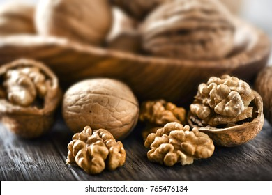 Walnuts on rustic table in wooden bowl, Walnut kernels, Walnut background