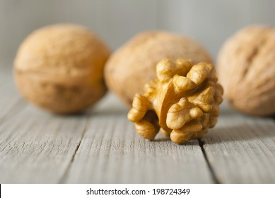 walnuts on weathered wooden table background, shallow depth of field