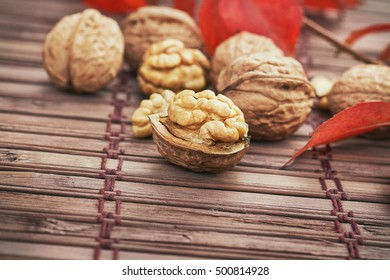 Walnuts on wooden background with copy space