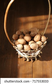 walnuts on a wooden brown table