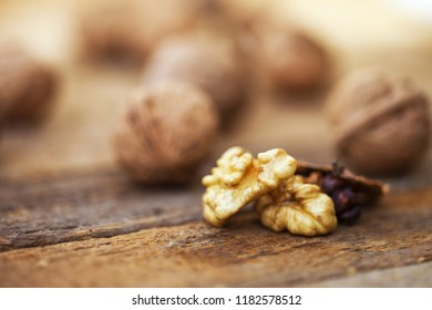 Walnuts on a wooden table. Macro image.