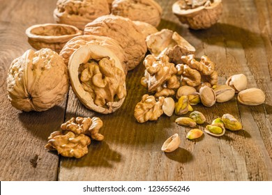Walnuts and pistachio nuts on a wooden table