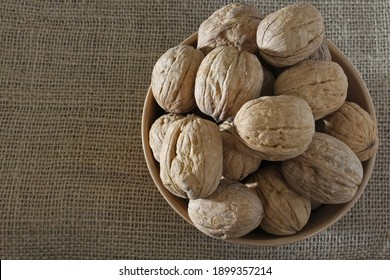 walnuts in a plate, top view