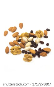 Walnuts with raisins and pistachios with almonds over white background.
