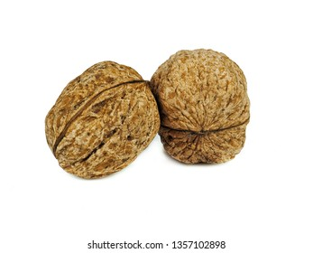 walnuts with shells. Unpeeled walnuts isolated on white background. Full depth of field.