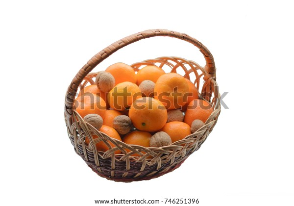 walnuts and tangerines in a brown wicker basket
