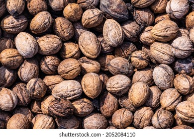 Walnuts unshelled. The concept of healthy, dietary products and proper nutrition, natural vitamins.