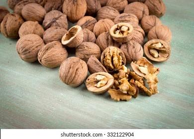 Walnuts whole in their skins, chopped, nut hulls, walnut kernels