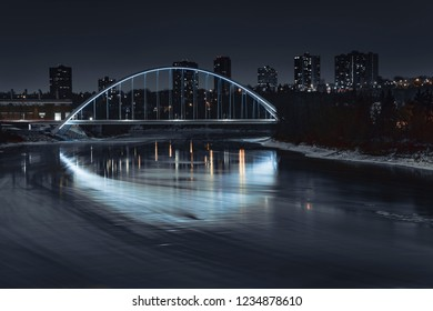 Walterdale Bridge spanning over the North Saskatchewan River in Edmonton, Alberta, Canada. Taken during a cold and cloudy winter night on November 19, 2018.