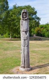 Waltham Abbey, UK - May 25th 2011: An oak sculpture by Helena Stylianides entitled Ancestor located in the grounds of Waltham Abbey Church in Waltham Abbey, Essex.