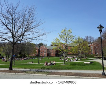 WALTHAM, USA - CIRCA APRIL 2018: Bentley University Campus with students sitting on the grass and relaxing