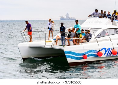 WALVIS BAY, NAMIBIA - JAN 7, 2016: Unidentified tourists on a boat at the Walvis Bay, The English referred to it English as Whale Bay.