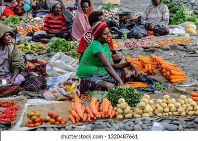 WAMENA, BALIEM VALLEY, WEST PAPUA - NOV 1, 2010: women sell vegetables in a simple market around Wamena, West Papua on November 1, 2010.