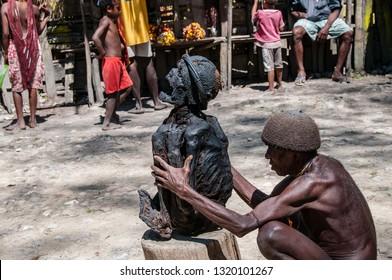 WAMENA, IRIAN JAYA, WEST PAPUA, INDONESIA - NOV 2, 2010: a shaman Dani exhibits the mummy of an ancestor during a ceremony in a village near Wamena, West Papua on november 2, 2010.