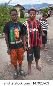 WAMENA, NEW GUINEA, INDONESIA - JANUARY 07: Unknown Papuan in everyday life in Wamena, New Guinea Island, Indonesia on January 07, 2009