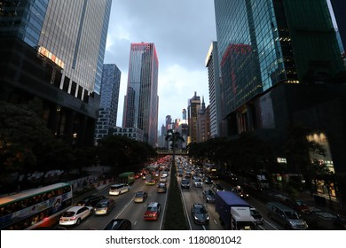 WAN CHAI, HONG KONG- AUGUST 30, 2018- In the wet drizzling rainy afternoon the commercial shopping area of Wan Chai and surroundings are busy as any other rush hour traffic.