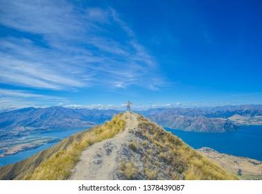 Wanaka, New Zealand, Feb 9th, 2019: Roys peak summit, with Lake Wanaka or Lake Hawea , one of the best track in New Zealand.